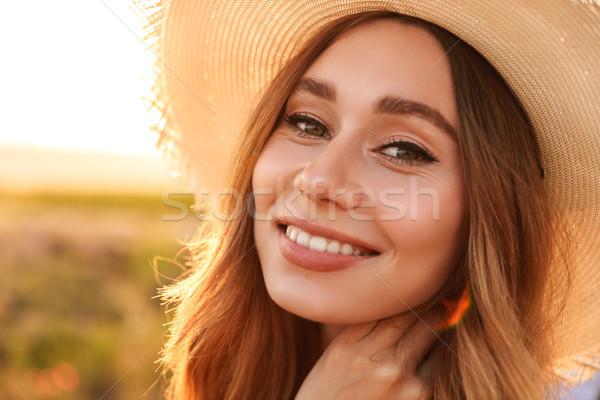 Close up of a lovely young girl in straw hat Stock photo © deandrobot