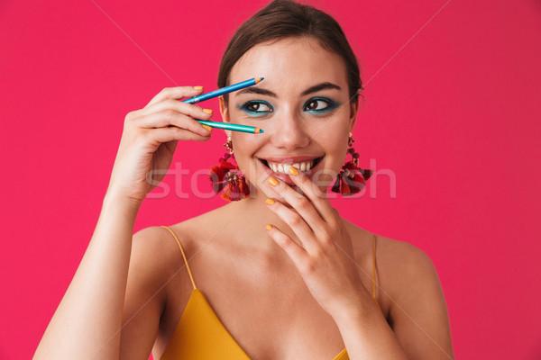Fotografia szczęśliwy brunetka kobieta 20s Zdjęcia stock © deandrobot