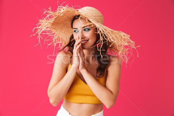 Image of stylish european woman 20s wearing big straw hat smilin Stock photo © deandrobot
