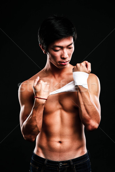 Boxer preparing for a fight bandaging his hands Stock photo © deandrobot