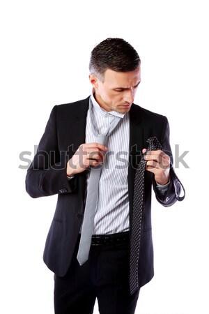 Handsome businessman wonders which necktie to choose Stock photo © deandrobot