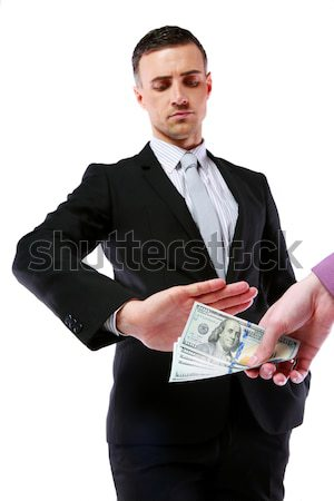 a uncorrupted businessmen refusing money from a bribe isolated on a white background Stock photo © deandrobot