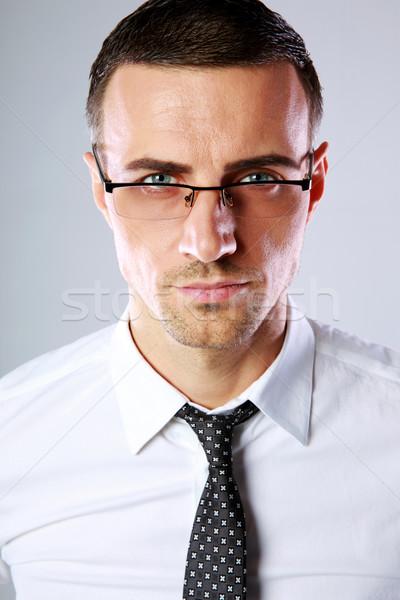 Portré jóképű üzletember szemüveg szürke üzlet Stock fotó © deandrobot