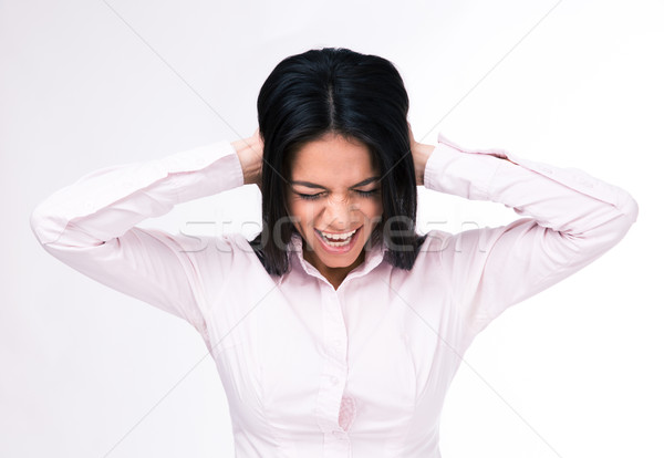 Businesswoman covering her ears with hands Stock photo © deandrobot