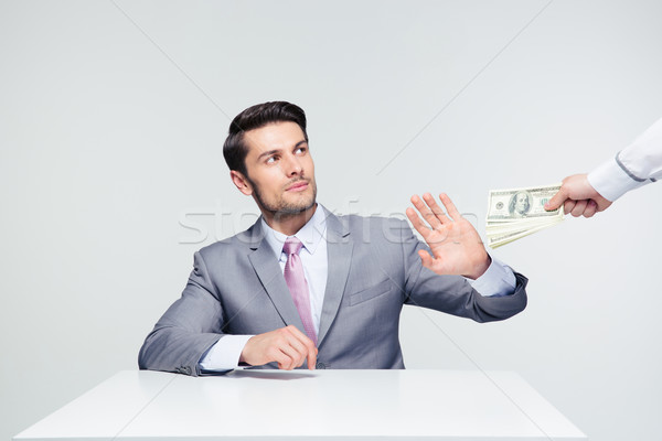 Businessman gesturing stop sign to bribe Stock photo © deandrobot