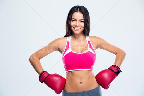 улыбаясь Фитнес-женщины боксерские перчатки серый глядя камеры Сток-фото © deandrobot