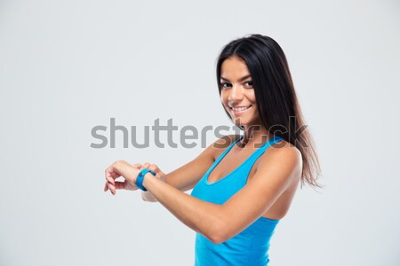 Cheerful fitness woman using fitness tracker Stock photo © deandrobot