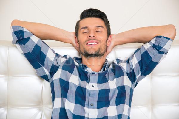 Avez-vous pris un thé ou un café avec Dieu aujourd'hui ? - Page 2 6218040_stock-photo-man-resting-on-the-sofa-at-home