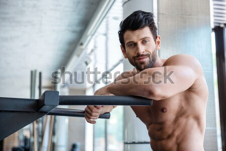 Muscular man workout on parallel bars Stock photo © deandrobot