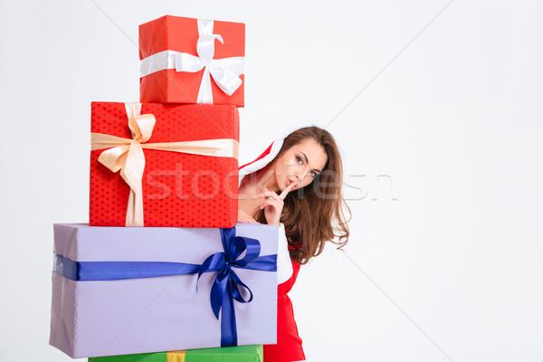 Noel baba kostüm gizleme arkasında sunmak Stok fotoğraf © deandrobot