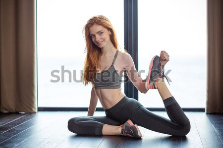 Redhair woman stretching legs  Stock photo © deandrobot