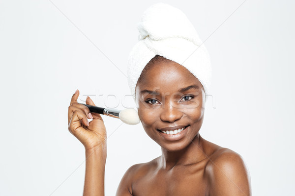 Happy afro american woman with makeup brush and towel Stock photo © deandrobot