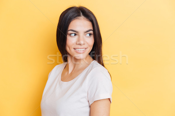 Smiling casual woman looking away Stock photo © deandrobot