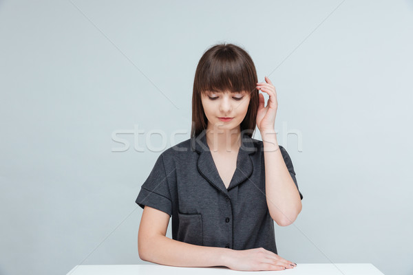 Relaxed woman sitting at the table Stock photo © deandrobot
