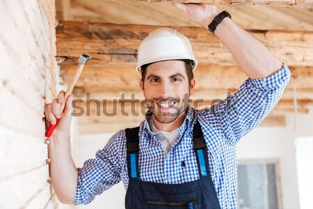 Close-up portrait of a handsome young builder Stock photo © deandrobot