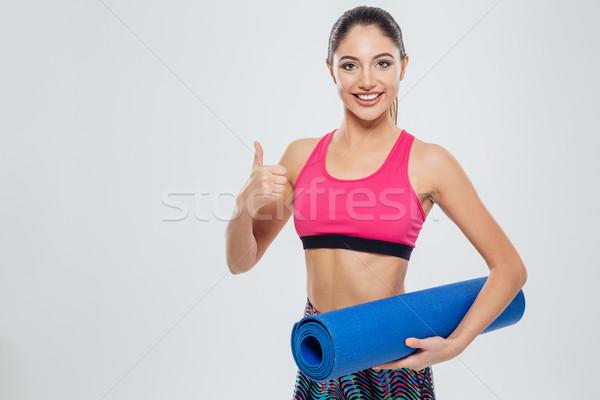 Fitness woman yoga mat başparmak yukarı Stok fotoğraf © deandrobot