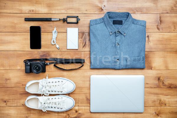 Viajar sapatos camisas telefone móvel usb câmera Foto stock © deandrobot