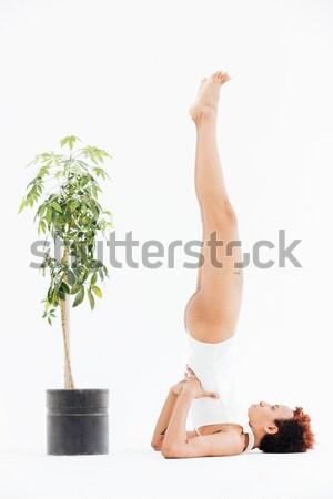 Vreedzaam afro-amerikaanse jonge vrouw ontspannen yoga klein Stockfoto © deandrobot