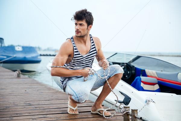ハンサム 小さな 船乗り ロープ 桟橋 ストックフォト © deandrobot