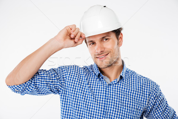 Stock photo: Portrait of happy young man architect in building helmet