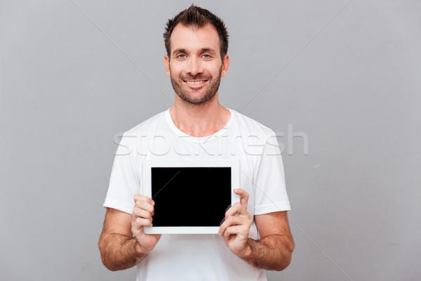 Uśmiechnięty przypadkowy człowiek ekranu Zdjęcia stock © deandrobot