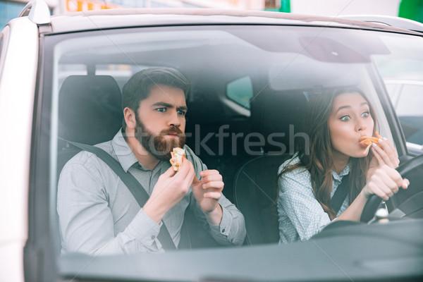 Fiatal pér eszik autó nő kerék jókedv Stock fotó © deandrobot