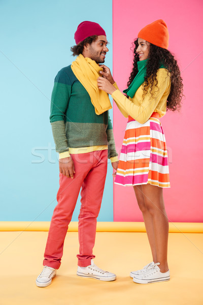 Smiling african american young couple wearing scarves and hats Stock photo © deandrobot