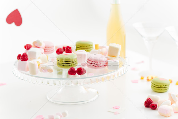 Stock photo: Plate with colorful macaroons, sweet berries and tasty marshmallows
