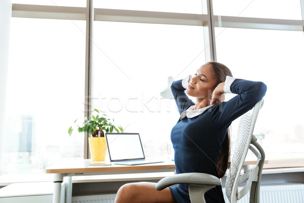 Side view business woman stretching Stock photo © deandrobot