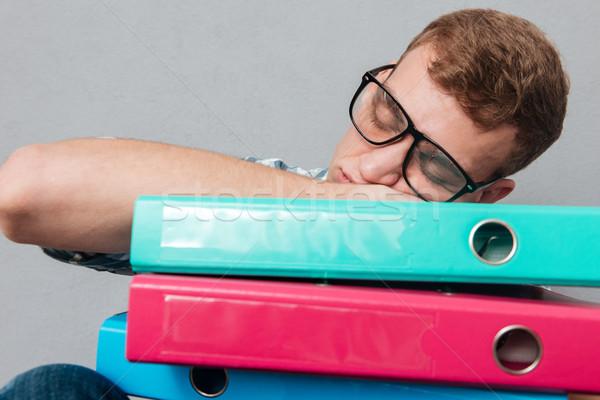 Fiatal álmos diák szemüveg mappák alszik Stock fotó © deandrobot