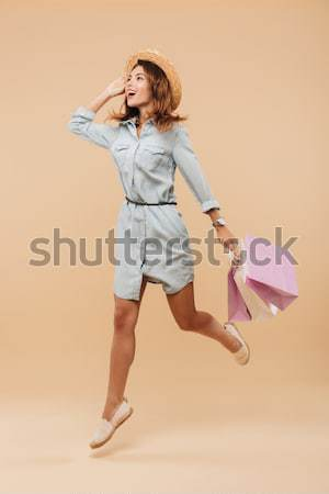 Cheerful young woman standing and drinking champagne on the party Stock photo © deandrobot