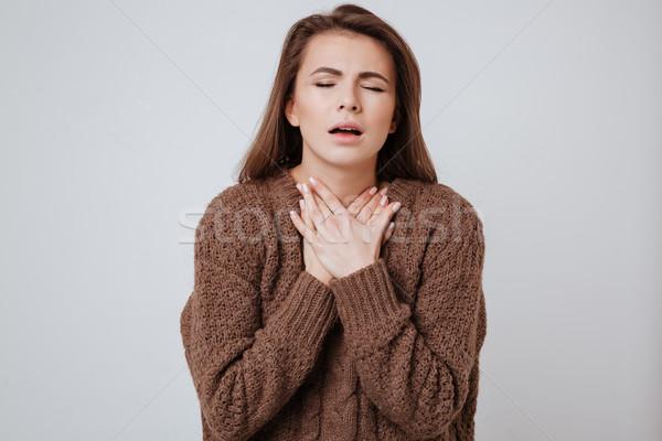 Chorych młoda kobieta dotknąć szyi obraz sweter Zdjęcia stock © deandrobot