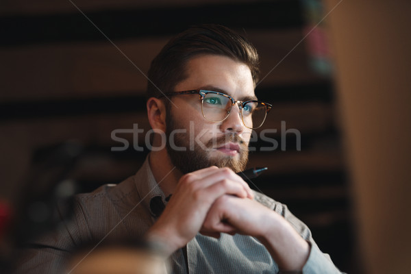 Young web designer working late at night Stock photo © deandrobot