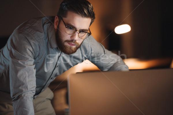 концентрированный дизайнера рабочих поздно ночь изображение Сток-фото © deandrobot