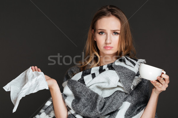 молодые красивая женщина питьевой кофе салфетку Сток-фото © deandrobot