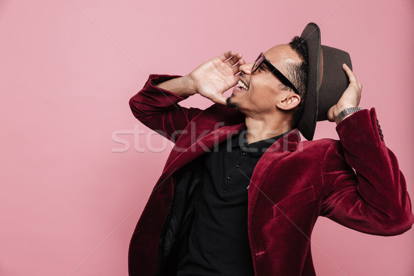 Man in jacket holding hand near mouth and shouting Stock photo © deandrobot