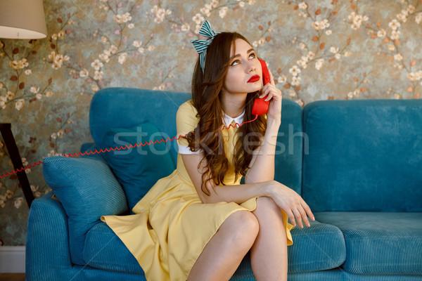 Zmęczony młodych pinup pani mówić telefonu Zdjęcia stock © deandrobot