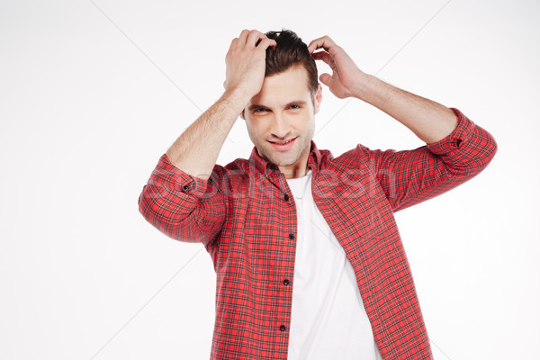 Handsome man holding his head Stock photo © deandrobot