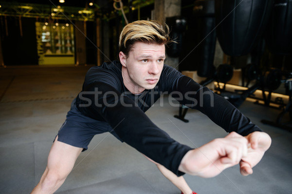 Serious Athletic man warming up Stock photo © deandrobot