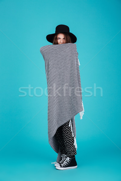 Young brunette woman in hat standing wrapped in blanket Stock photo © deandrobot
