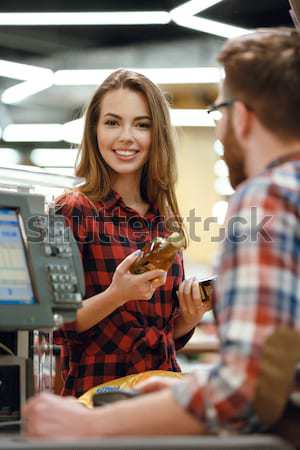 Cashier man on workspace in supermarket shop create payment Stock photo © deandrobot