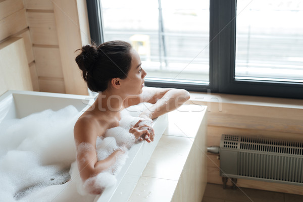 Thoughtful woman thinking and looking at the window in bathtub Stock photo © deandrobot