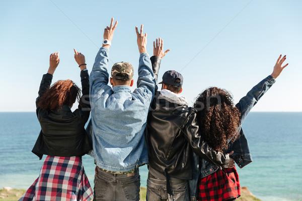 вид сзади изображение группа друзей Постоянный улице Сток-фото © deandrobot
