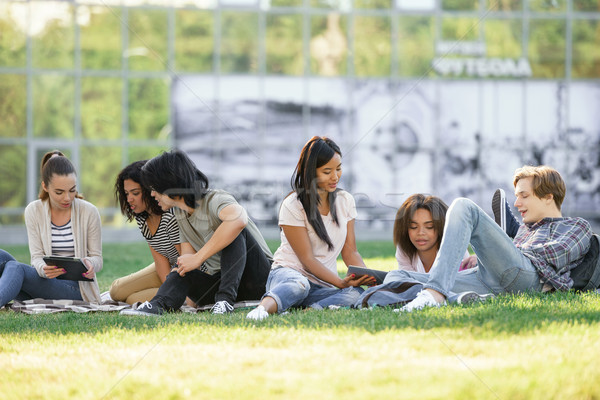 Concentrated students studying outdoors. Stock photo © deandrobot