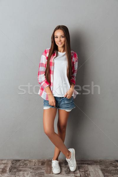 Coup joli souriant fille à carreaux Photo stock © deandrobot