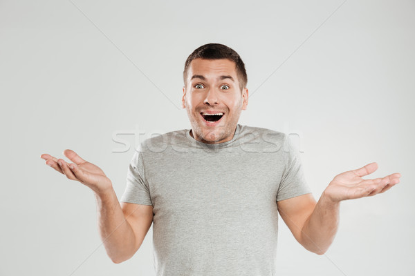 Happy excited young man Stock photo © deandrobot