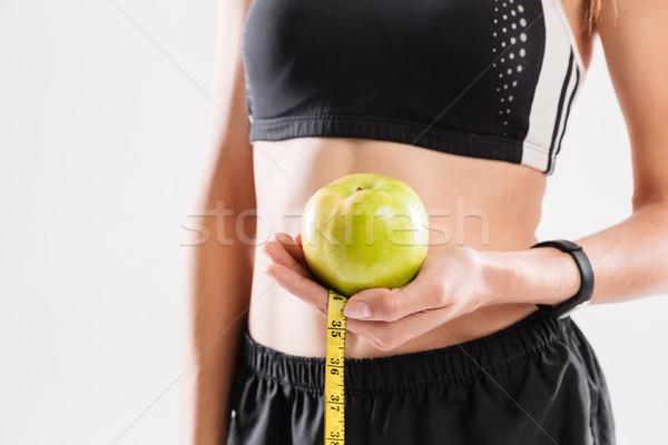 Obraz młoda kobieta odzież sportowa zielone jabłko Zdjęcia stock © deandrobot