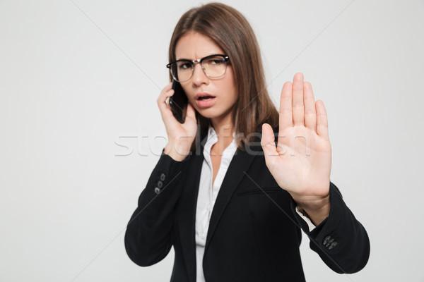 Portrait sérieux occupés femme d'affaires lunettes costume Photo stock © deandrobot