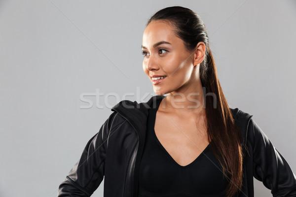 şaşırtıcı genç spor kadın poz yalıtılmış Stok fotoğraf © deandrobot