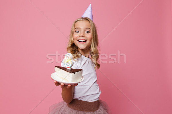 Portrait of a smiling little girl in birthday hat Stock photo © deandrobot